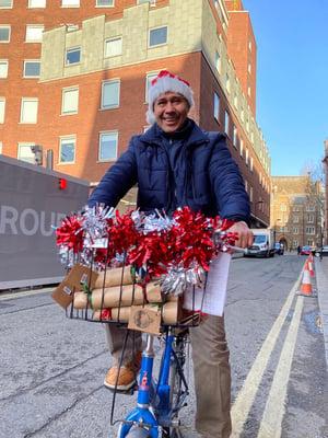 santa-on-bike-delivering-presents-sustainable